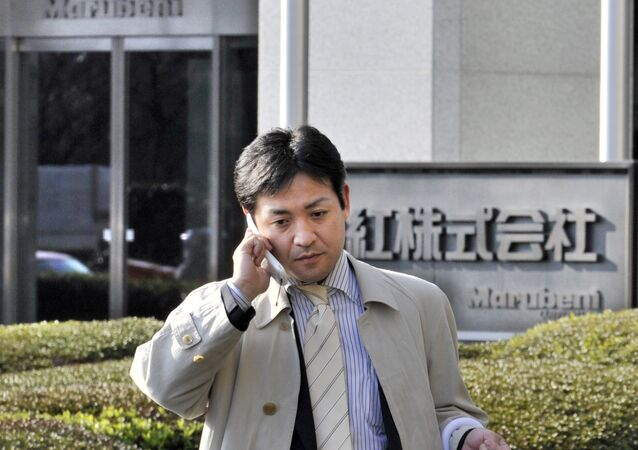 A Japanese businessman walks in front of Japanese trading company Marubeni in Tokyo