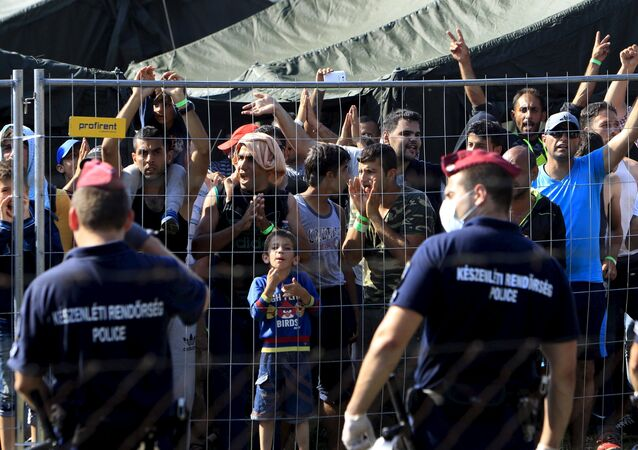 Syrian migrants shout slogans at a refugee camp in Roszke, Hungary, August 28, 2015