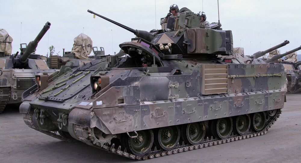 Soldiers from the 2nd Battalion, 12th Cavalry Regiment, 1st Brigade Combat Team, 1st Cavalry Division, prepare to qualify on their M2A3 Bradley Fighting Vehicle Oct. 6, 2014 in Grafenwoehr, Germany