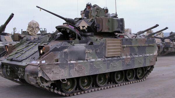 Soldiers from the 2nd Battalion, 12th Cavalry Regiment, 1st Brigade Combat Team, 1st Cavalry Division, prepare to qualify on their M2A3 Bradley Fighting Vehicle Oct. 6, 2014 in Grafenwoehr, Germany - Sputnik International