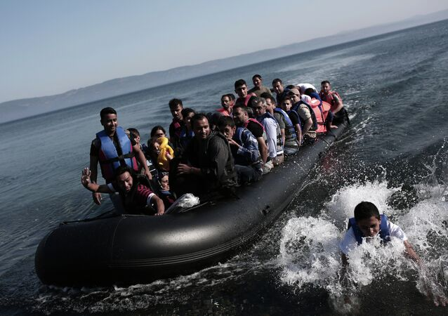 Refugees coming from Turkey land on the shores of the Greek island Lesbos in an inflatable boat on September 4, 2015