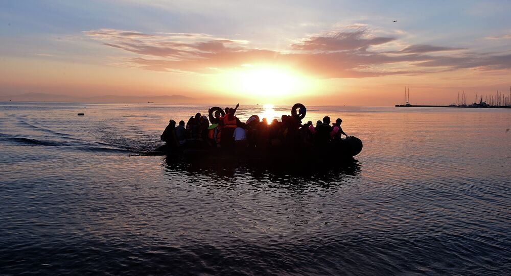 Syrian migrants arrive on an overcrowded dinghy to the coast of the southeastern Greek island of Kos from Turkey, on August 15, 2015