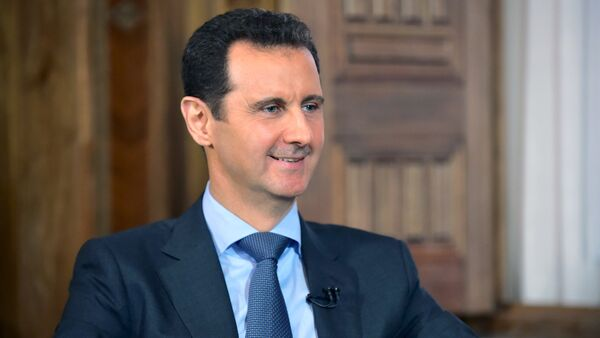 Syria's President Bashar al-Assad answers questions during an interview with al-Manar's journalist Amro Nassef, in Damascus, Syria, in this handout photograph released by Syria's national news agency SANA on August 25, 2015 - Sputnik International