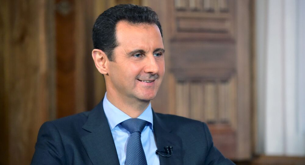 Syria's President Bashar al-Assad answers questions during an interview with al-Manar's journalist Amro Nassef, in Damascus, Syria, in this handout photograph released by Syria's national news agency SANA on August 25, 2015