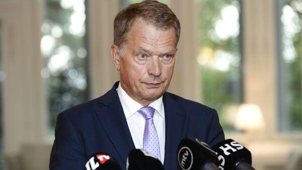Finnish President Sauli Niinisto speaks to media in Helsinki, Finland on Thursday, Aug. 14, 2014 - Sputnik International