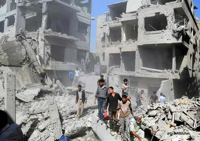 Syrians inspecting damage following a Syrian government airstrike on the Damascus suburb of Douma, Syria, Saturday, Aug. 22, 2015