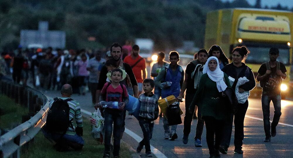 People walk in a long line along the highway near Budapest, Hungary, heading for the Austrian border.