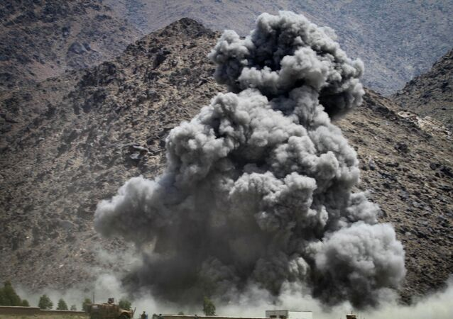 Smoke rises after a coalition air strike against a building believed occupied by Taliban fighters in Kuz Kunar, Nangarhar province east of Kabul.