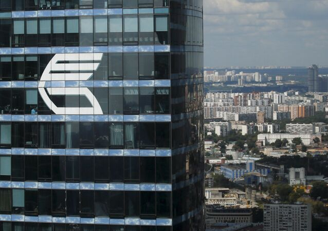 The logo of VTB Group is seen through a window of Imperia Tower on the facade of the Federatsiya (Federation) Tower at the Moscow International Business Center also known as Moskva-City, in Moscow, Russia, in this August 5, 2015 file photo