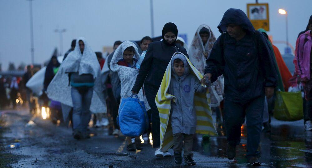 Migrants arrive at the Austrian-Hungarian border station of Hegyeshalom, Hungary, September 5, 2015