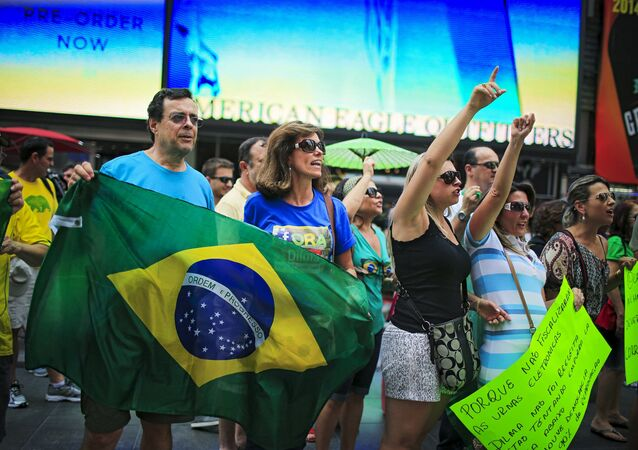Demonstrators shout slogans against Brazil's President Dilma Rousseff while they attend a protest at Times Square in New York August 16, 2015