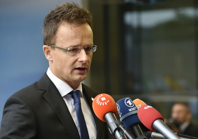 Hungary Foreign Affairs Peter Szijjarto answers journalits' questions on the second day of the EU Foreign Affairs Council meeting in Luxembourg on September 5, 2015