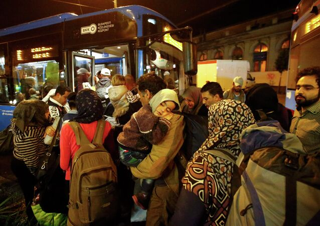 Migrants enter a bus, which is supposed to leave to Austria and Germany, at the Keleti trainstation in Budapest, Hungary, September 4, 2015