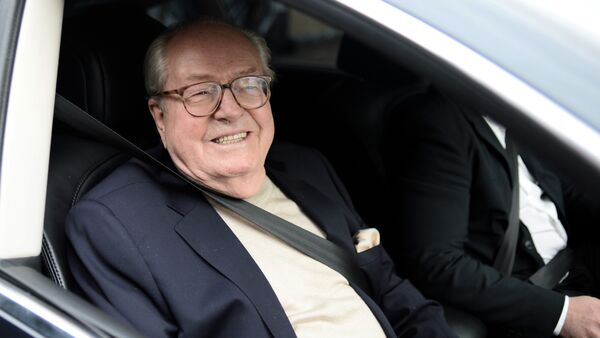 France's far-right party Front National (FN) honorary president Jean-Marie Le Pen smiles as he leaves the party's headquarters in Nanterre, near Paris - Sputnik International