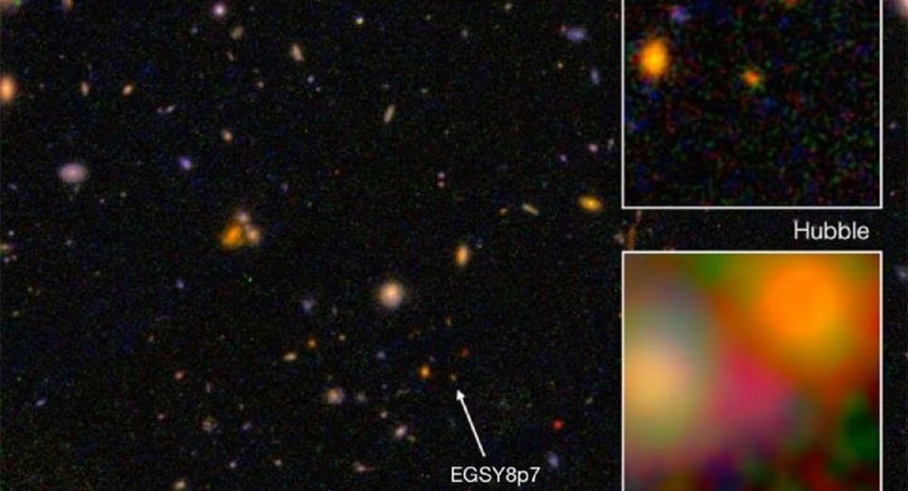 This is galaxy EGS8p7, as seen from the Hubble Space Telescope (wide and top right) and Spitzer Space Telescope (inset, bottom right), taken in infrared.