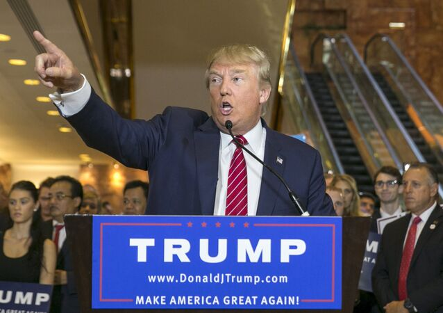 U.S. presidential hopeful Donald Trump speaks during a press availability after signing a pledge with the Republican National Committee (RNC) at Trump Tower in Manhattan, New York September 3, 2015
