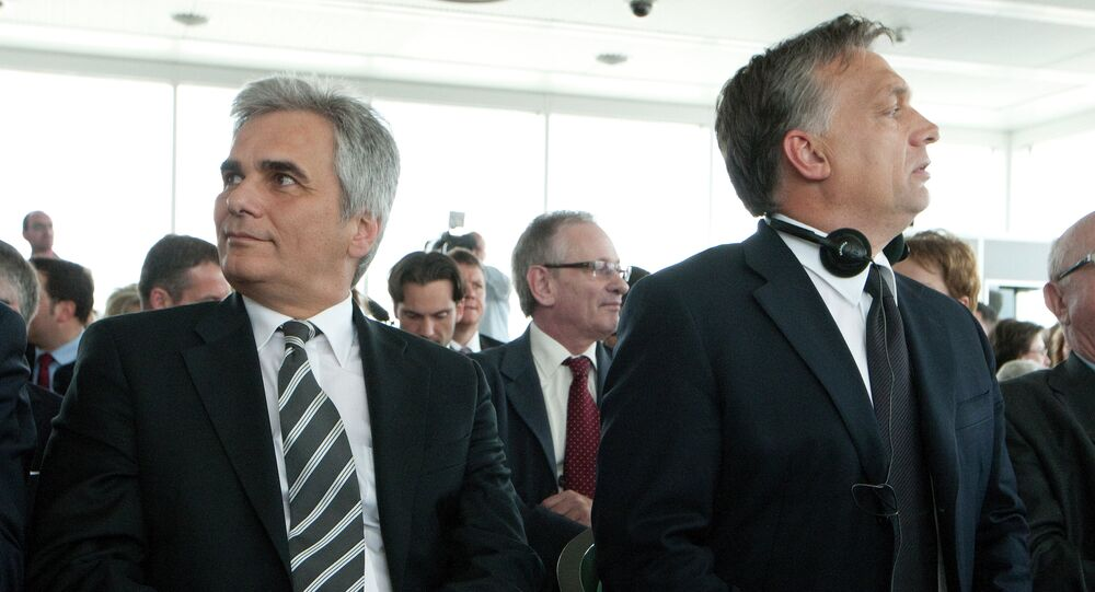 Hungarian Prime Minister Viktor Orbán sits with Austrian Chancellor Werner Faymann on June 12, 2012 during his visit to Vienna