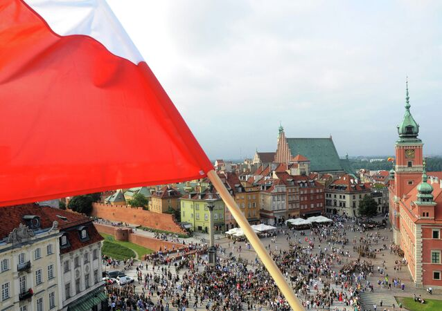 A Polish national flag waves above the Zamkowy Square.