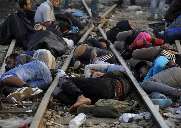 Refugees and migrants sleep on the railway tracks close to the borders of Greece with Macedonia, near the village of Idomeni, September 6, 2015