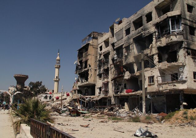A damaged residential building in the Yarmouk refugee camp on the outskirts of Damascus