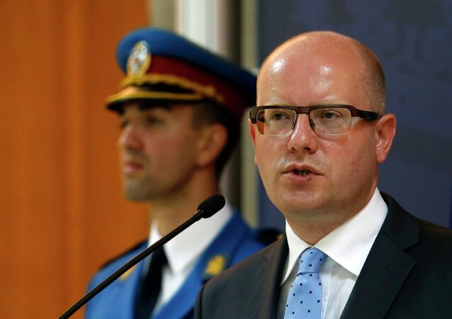 Czech Prime Minister Bohuslav Sobotka speaks during a press conference after talks with his Serbian counterpart Aleksandar Vucic, unseen, in Belgrade, Serbia, Tuesday, Sept. 1, 2015