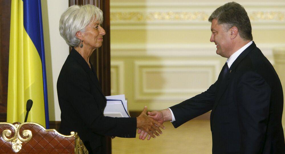 Ukrainian President Petro Poroshenko greets International Monetary Fund (IMF) Managing Director Christine Lagarde after a news conference in Kiev, Ukraine, September 6, 2015