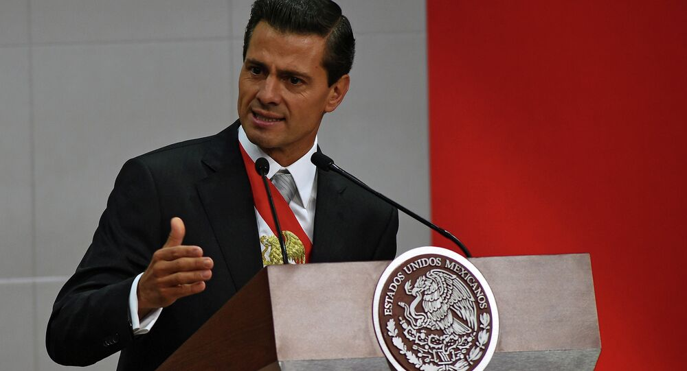 Mexican President Enrique Pena Nieto delivers his third annual report at the National Palace in Mexico City on September 2, 2015