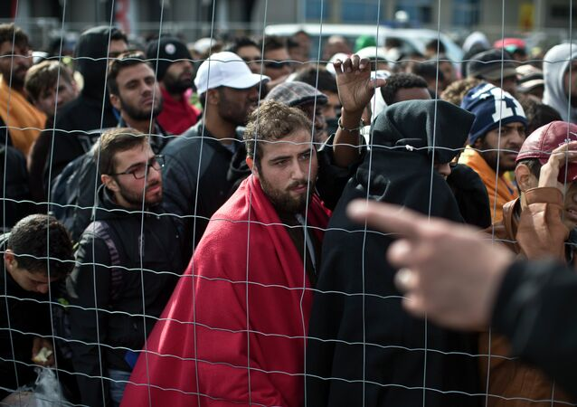 Migrants waiting in line to board buses in Hungary