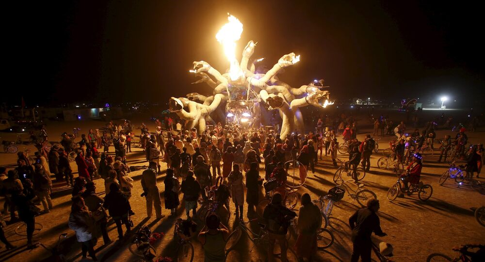 Participants gather at Medusa Madness during the Burning Man 2015 Carnival of Mirrors arts and music festival in the Black Rock Desert of Nevada, September 6, 2015