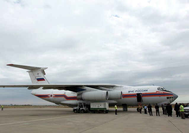 A Russia plane is seen on the tarmac after it landed in Baghdad carrying 37 tons of humanitarian aid to people