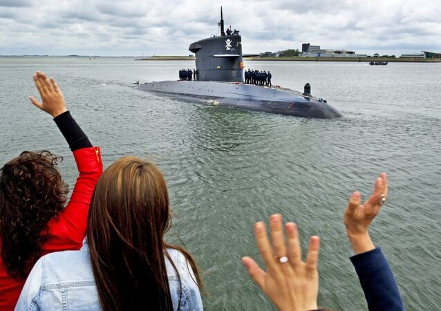 People wave at the Dutch submarine 'Hr. Ms. Dolfijn' in the harbor of Den Helder