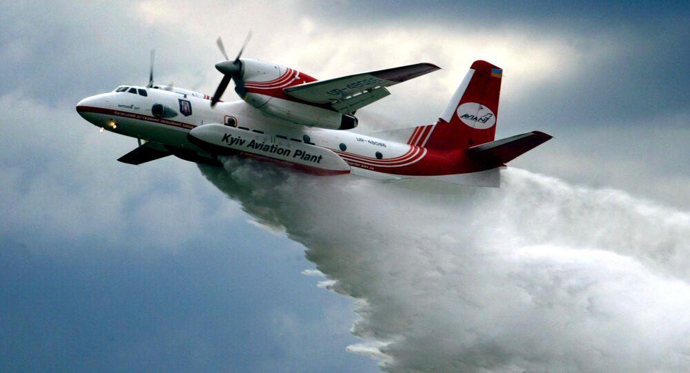 The Ukrainian made AN-32 firefighting aircraft pours water.