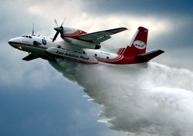 The Ukrainian made AN-32 firefighting aircraft pours water.