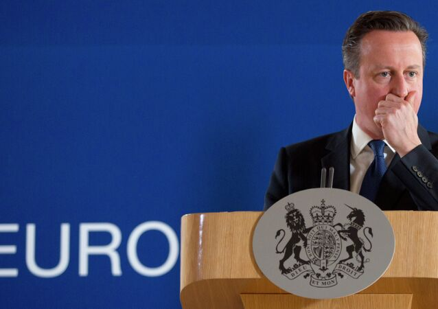 British Prime Minister David Cameron pauses before speaking during a final media conference after an EU summit in Brussels on Friday, June 26, 2015.