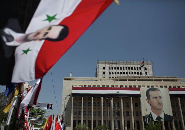 Portrait of President Bashar al-Assad on the Bank of Syria building in Damascus.