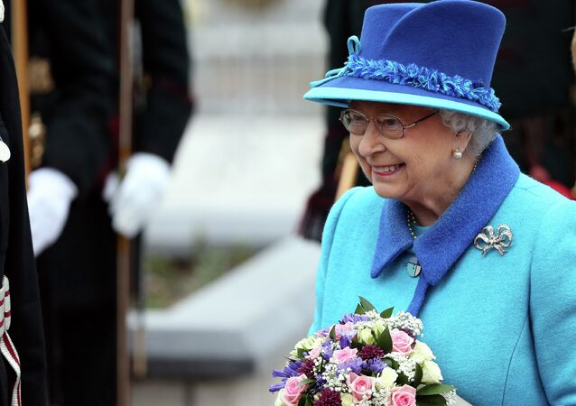 Britain's Queen Elizabeth II attends the opening ceremony for the Borders railway route at Tweedbank station, Scotland, Wednesday Sept. 9, 2015.