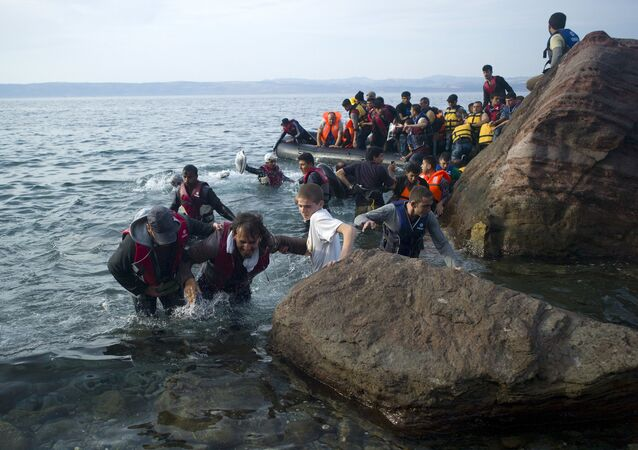 Refugees and migrants arrive on a beach on the Greek island of Lesbos, September 9, 2015.