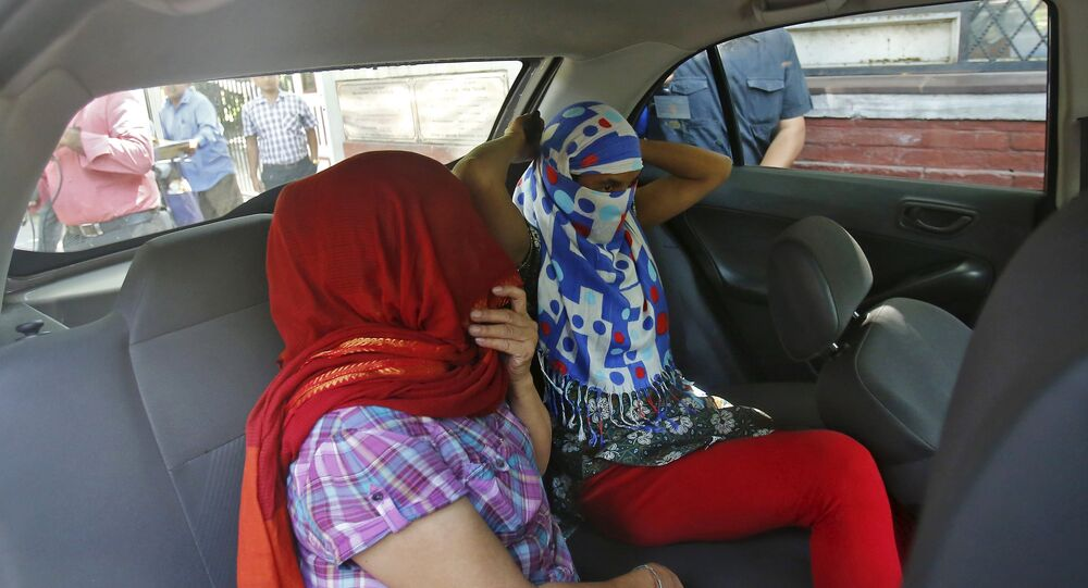 Two veiled Nepali women, who told police they were raped by a Saudi official, sit in a vehicle outside Nepal's embassy in New Delhi, India, September 9, 2015.