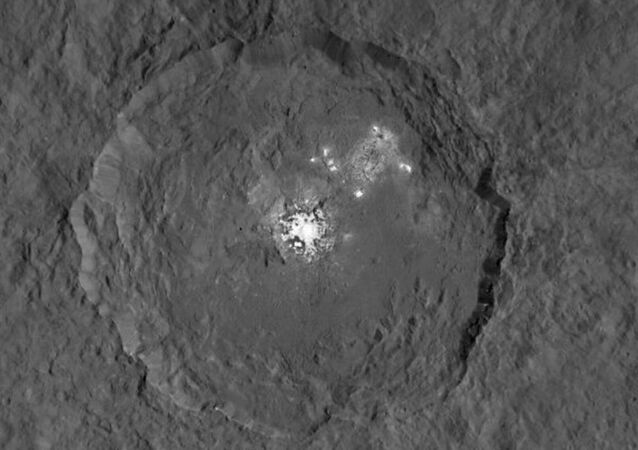 Occator Crater on dwarf planet Ceres, seen from orbit of 915 miles