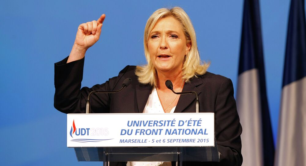 President of France's far right National Front party Marine Le Pen, delivers her speech during their summer meeting, in Marseille, southern France, Saturday, Sep. 6, 2015.