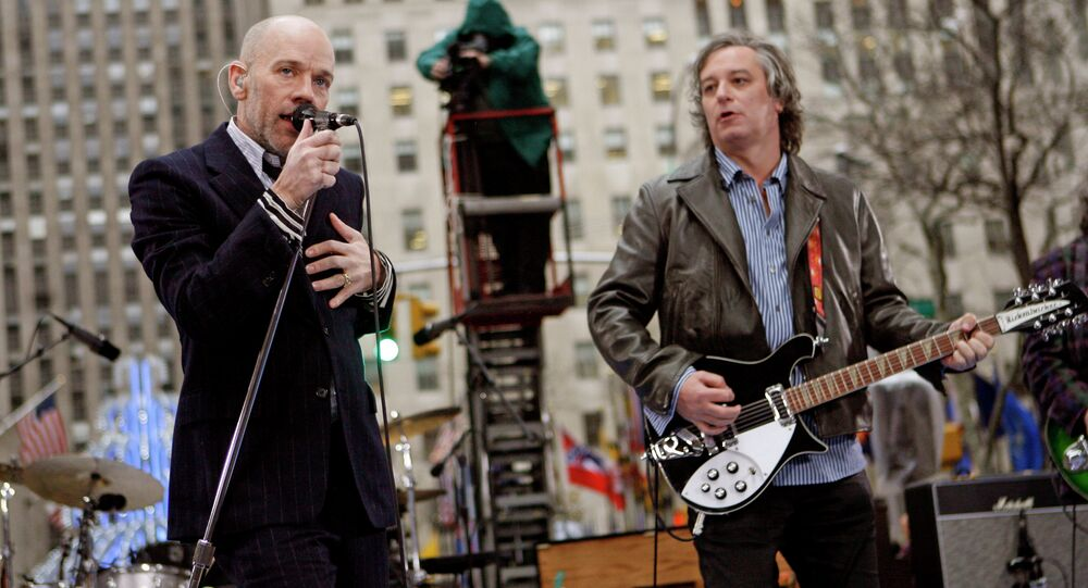 Michael Stipe, left, Peter Buck, right, and R.E.M. perform on NBC's Today in New York's Rockefeller Plaza
