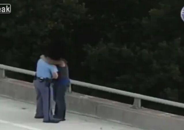 North Carolina police officer talks man off Bridge.