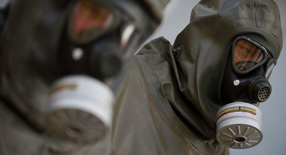 Employees in protective gear are seen during a demonstration in a chemical weapons disposal facility at GEKA (Gesellschaft zur Entsorgung von chemischen Kampfstoffen und Ruestungsaltlasten) in Munster, northern Germany, on October 30, 2013