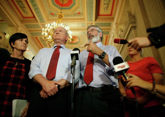 Sinn Fein party leader Gerry Adams, right, and Martin McGuinness speak to the media at Parliament Buildings, Stormont, Belfast, Northern Ireland, Thursday, Sept. 10, 2015.