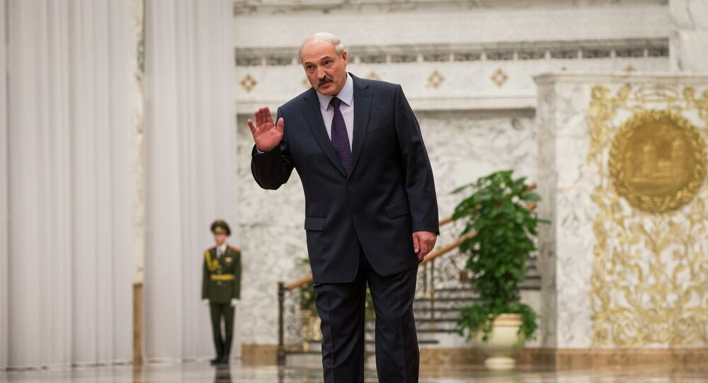 Belarusian President Alexander Lukashenko greets journalists as he attends the arrival ceremony in Minsk, Belarus, Wednesday, Feb. 11, 2015