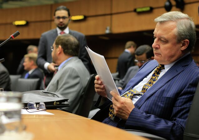 Russia's ambassador to the International Atomic Energy Agency (IAEA) Grigory Berdennikov reads documents as he attends the Board of Governors meeting at the UN atomic agency headquarters in Vienna on September 11, 2013