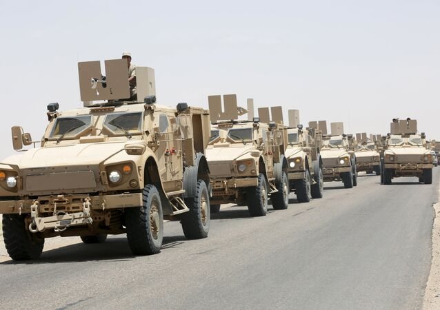 Military vehicles carrying Gulf Arab soldiers arrive at Yemen's northern province of Marib September 8, 2015