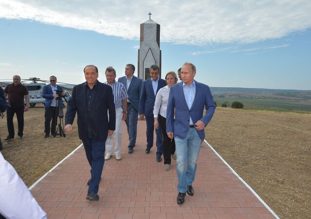 Russian President Vladimir Putin and former Italian Prime Minister Silvio Berlusconi at the monument to Sardinians killed in the Crimean War, September 11, 2015.