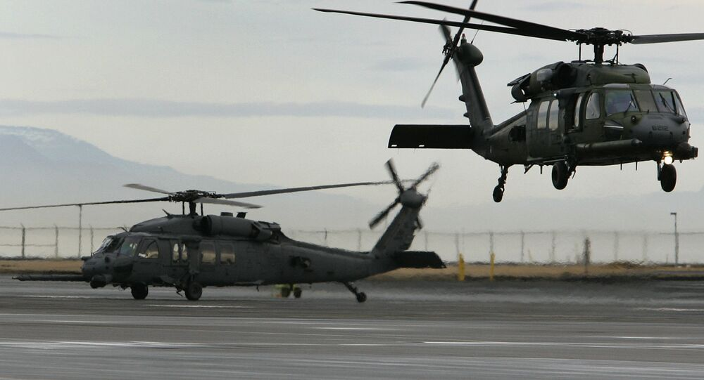 Helicopters make a training flight at the Keflavik US Air Base, Keflavik, Iceland, Friday Feb. 24, 2006