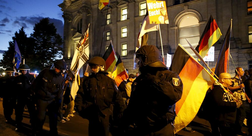German police officers escort members of BAERGIDA, Berlin's section of anti-immigration movement Patriotic Europeans Against the Islamisation of the West (PEGIDA), during a rally as they walk next to the Reichstags building in Berlin, Germany September 7, 2015